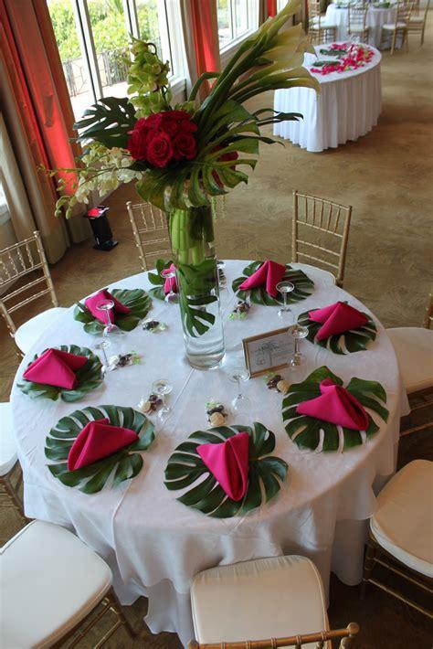 flower table decorations for weddings monstera leaf tropical reception wedding flowers wedding