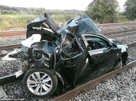 Shocking Moment Train Crashes Into Car Abandoned On