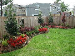 flower beds  fence  backyard landscaping yard