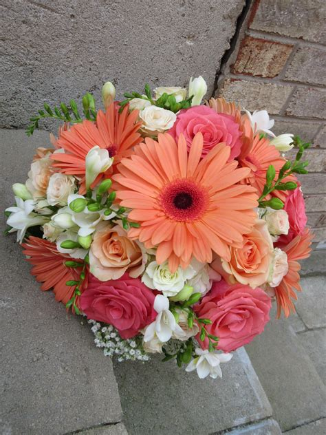 wedding bouquet of freesia roses gerbera daisies and