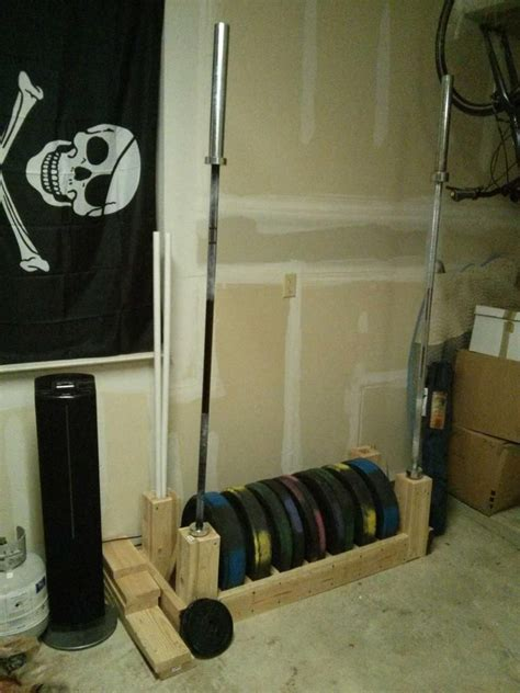 diy bumper plate  barbell storage photo   home gym  equipment workout backyard gym