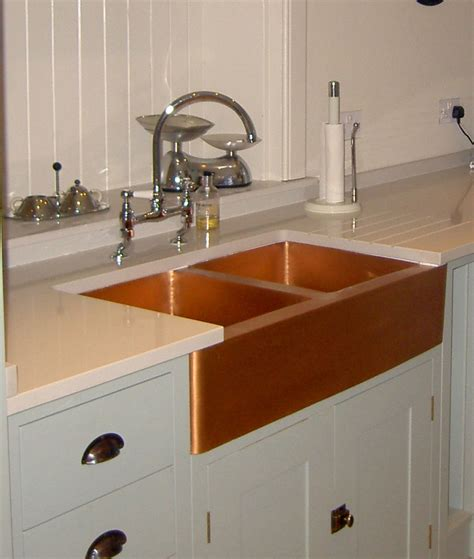 white kitchen cabinets with copper sink quicua