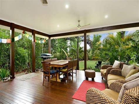 modern garden design using glass with verandah ground