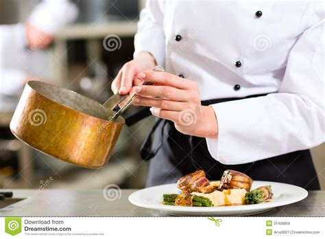 chef cuisine pic chef in hotel or restaurant kitchen cooking stock photo
