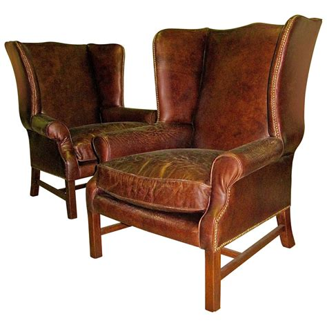 two george iii style wingback chairs with distressed