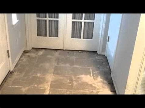 remove tile flooring  carpet overlay concrete stain