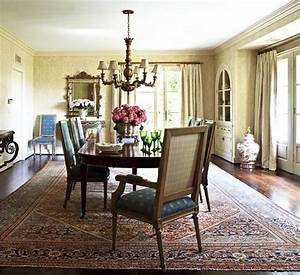 The dining room is filled with elegant custom pieces and