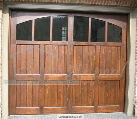 replacement wooden garage windows stained cedar carriage style garage door glass and arched top curb appeal contracting