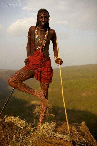 maasai warrior standing   edge  suswa crater zuru
