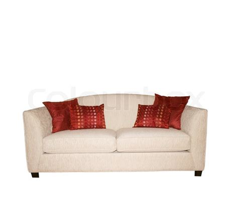 white sofa with colorful pillows white sofa with decorative red pillows isolated on white