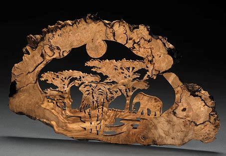 scroll  patterns wildlife elephants plaque
