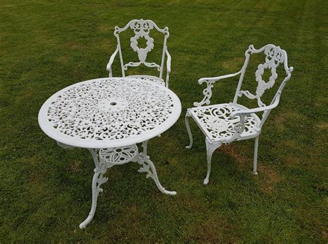 white metal garden table and 2 chairs in three rivers for