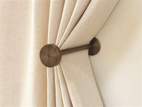 holdbacks for curtains brushed bronze curtain holdbacks simple design