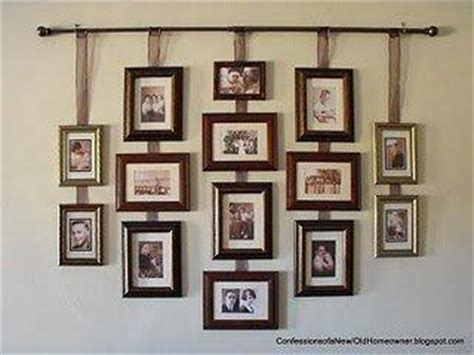 hanging pictures from curtain rod with ribbon this