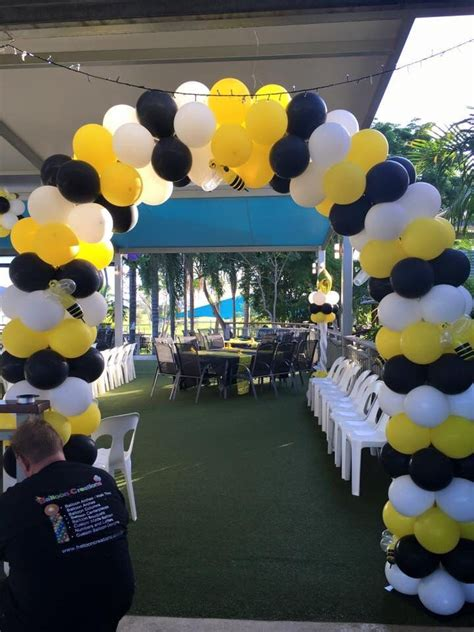 yellow black  white balloon arch   cute