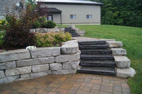 2 Tiered Random Flagstone Patio With Armour Stone Walls