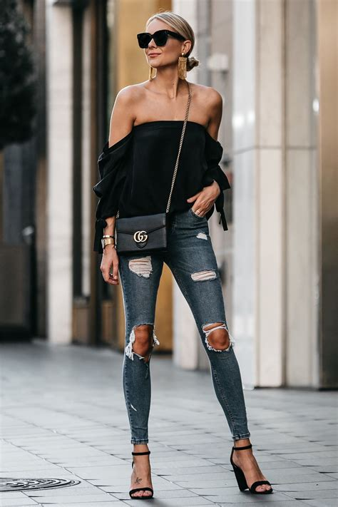 Blonde Woman Wearing Club Monaco Black Off-the-Shoulder Top Denim Ripped Skinny Jeans Outfit ...