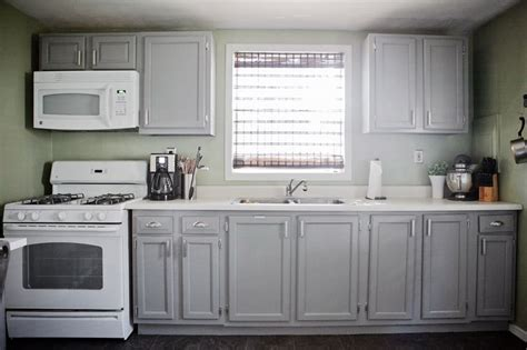 green kitchen cabinets with white appliances gray cabinets green walls white appliances cabinets are