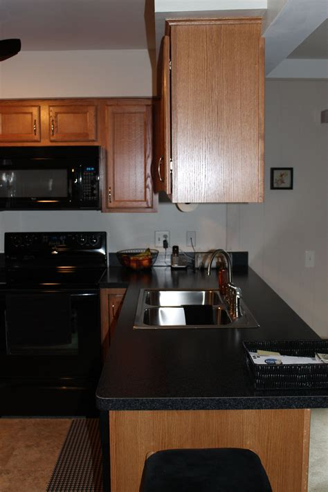 kitchen cabinets with light countertops medium light shaker style cabinetry peninsula area with 9536