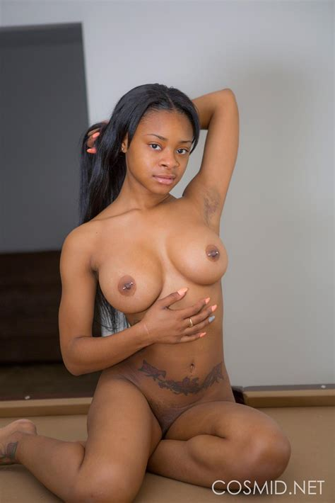 Busty Ebony Girl Mechelle Strips For You On The Table