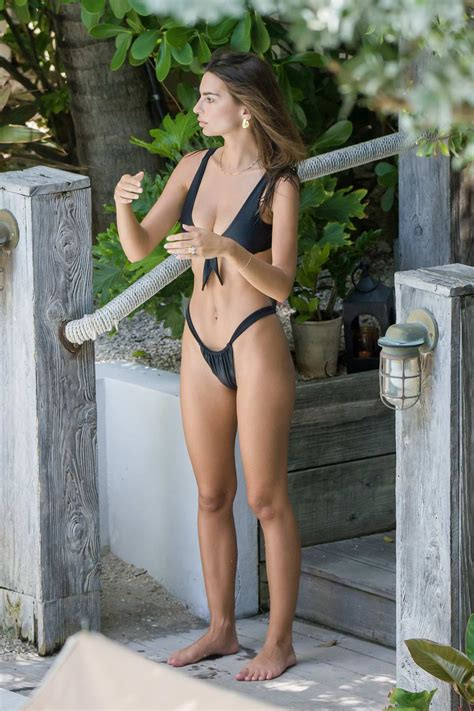 emily ratajkowski slips into a black bikini while lounging ...