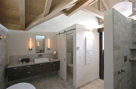 15 sliding barn doors that bring rustic to the bathroom