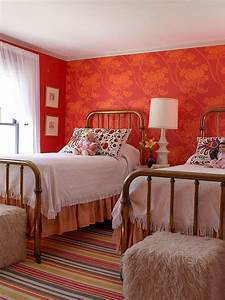 Modern farmhouse style bedroom with red and orange ...