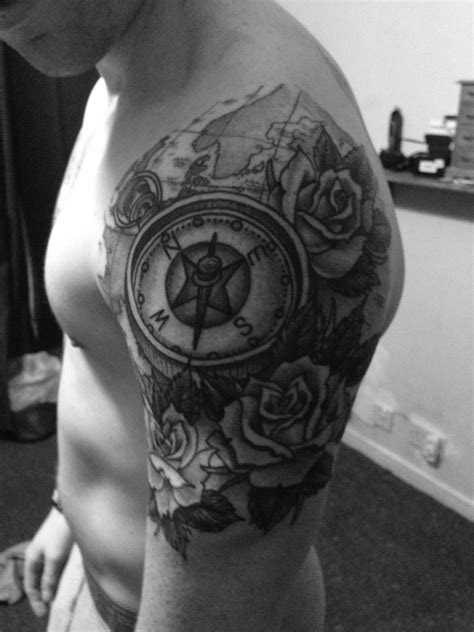 My new quarter sleeve rose and compass tattoo.... by Ross