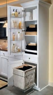 linen closet with chrome shelving rack on door and a