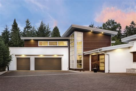 clopay s modern garage doors both shield and impress architect magazine