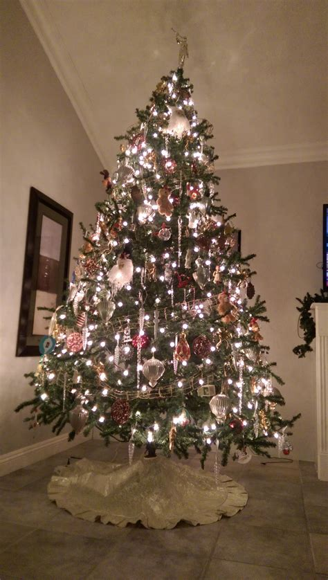 large christmas tree white lights armchairdecoratorblog