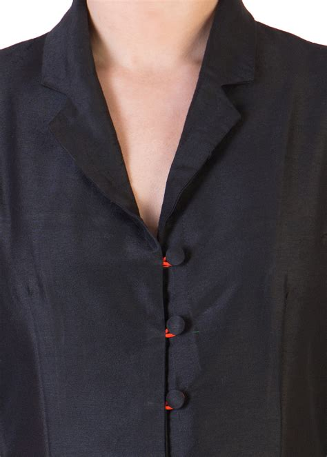 black dress  orange button loops  ans  secret label