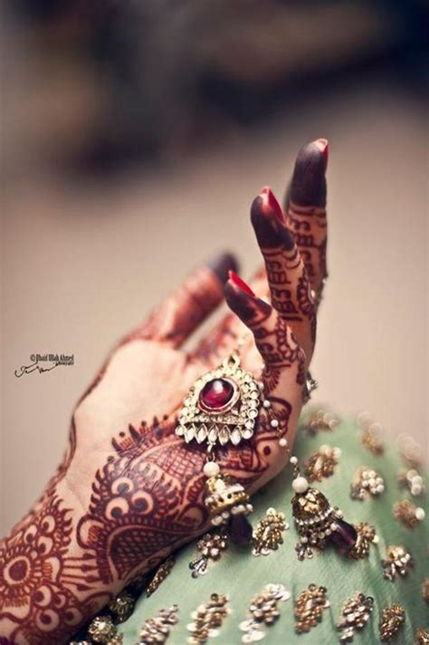 At the same time, the question what hand is appropriate for a wedding ring? isn't directly connected with religious difference. Bridal Mehndi Hands And Bangles Photography - XciteFun.net