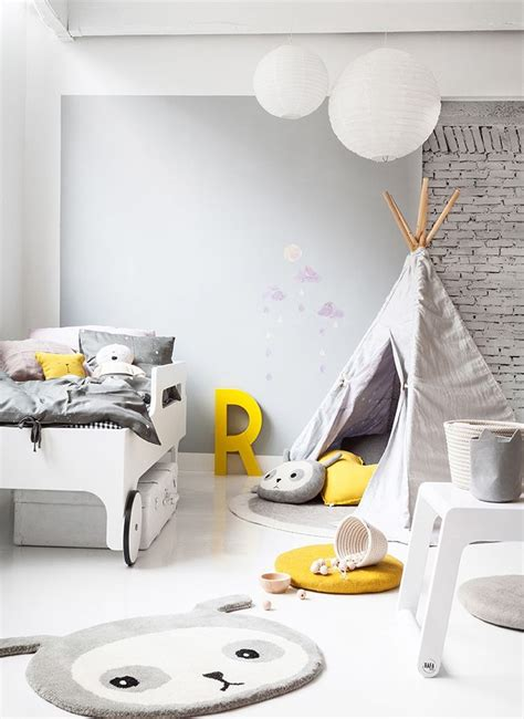 great modern gender neutral bedroom yellow accent   exposed brick wall kid bedroom sets