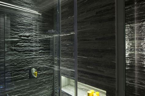 bathroom lighting stone tiles glass walls elegant