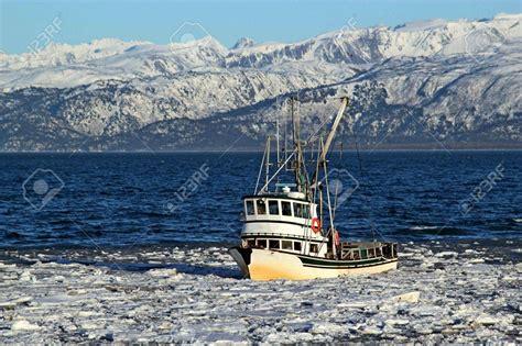 classic fishing boat traveling through in the kachemak