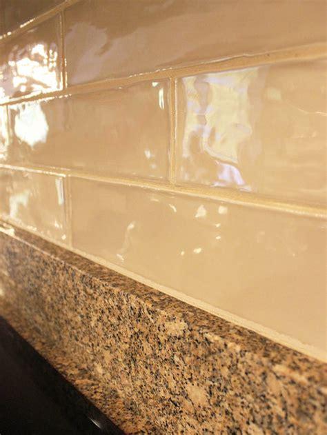 quartz island countertop  artigiano tile backsplash