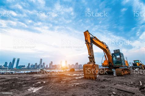 Excavator In Construction Site On Sunset Sky Background ...