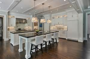 Kitchen Islands White Side By Side White Kitchen Islands With Honed Black Marble Countertops Transitional Kitchen