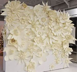 wedding backdrop Huge white paper flowers pinned on the