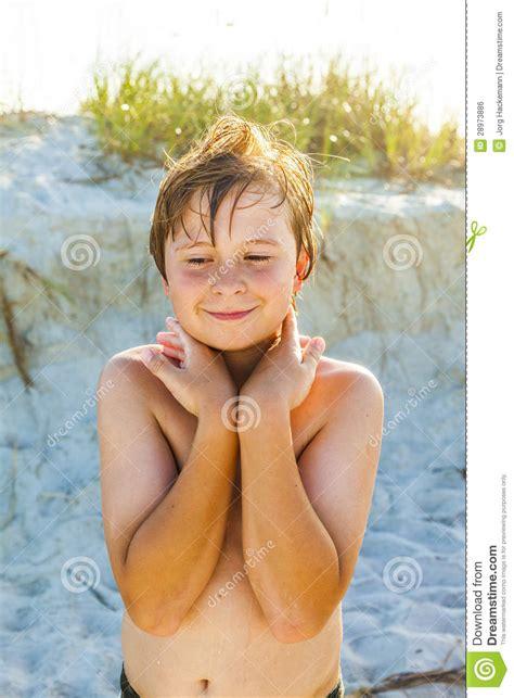 smiling boy  wet hair   beach royalty  stock
