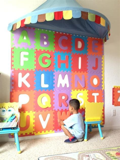 Glue foam floor letters to the wall. Alphabet foam wall