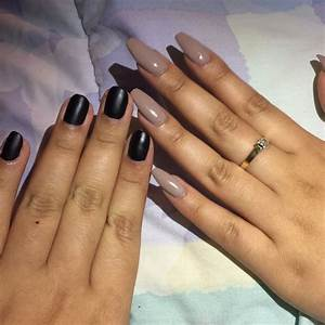 Natural rounded nails with a black matte polish and a full ...