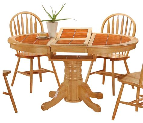 wooden table with tile top coaster damen round oval tile top pedestal table with leaf