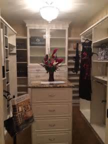 Walk-In Closet with Chandelier and Island
