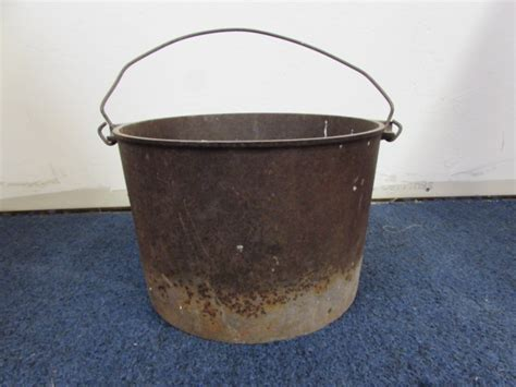 Rustic Cast Iron Bucket Full Of Ceramic Power