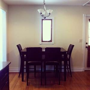 saving room by pushing the dining table against the wall n With dining room table with bench against wall