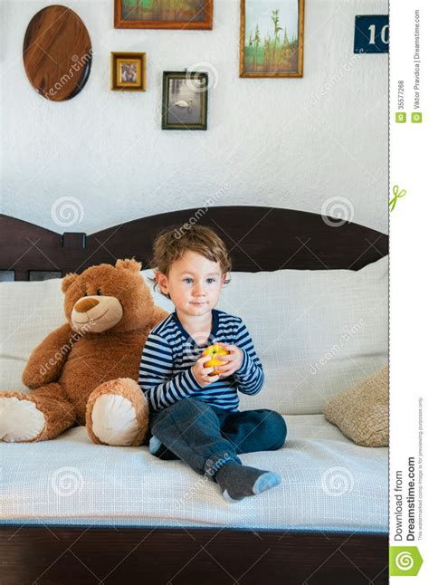 boy  home holding apple royalty  stock  image
