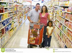 Young Family Grocery Shopping Stock Image - Image: 5096931