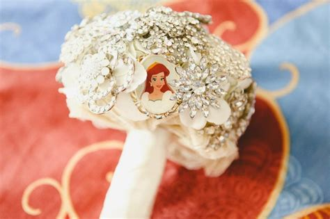 This was my brooch bouquet. I had to include my favorite princess, Ariel!! @Disney Weddings